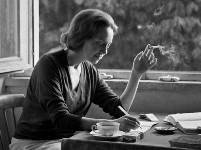 Sophia de Mello writing and smoking by the window